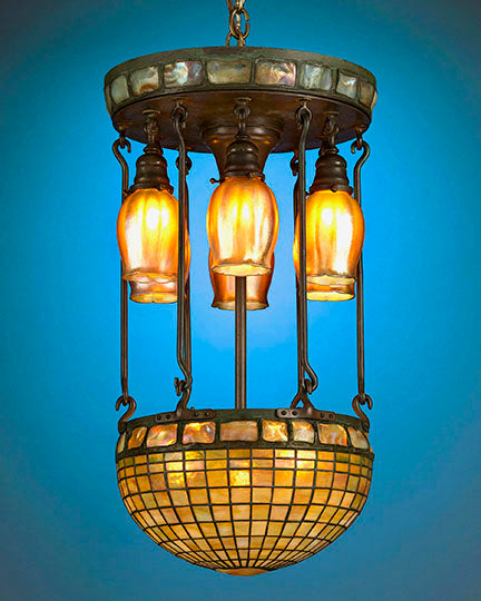 This important Tiffany Studios Favrile Glass Chandelier is crafted in a Moresque, or Moorish, Turtleback Tile motif, and is representative of Tiffany's most desired exotic geometric designs