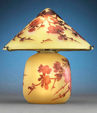 This enchanting cameo glass lamp is the work of the inimitable Emile Gallé. Entirely engraved and etched in a stunning pear blossom motif, this exquisite light beautifully displays Gallé's mastery of this delicate art form