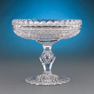 Distinguished by a ring of hobstars contrasted by smooth flutes circling the rim and center, this compote is a treasure for the American cut glass enthusiast.