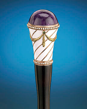 A stunning purple amethyst tops this elegant walking stick by Fabergé