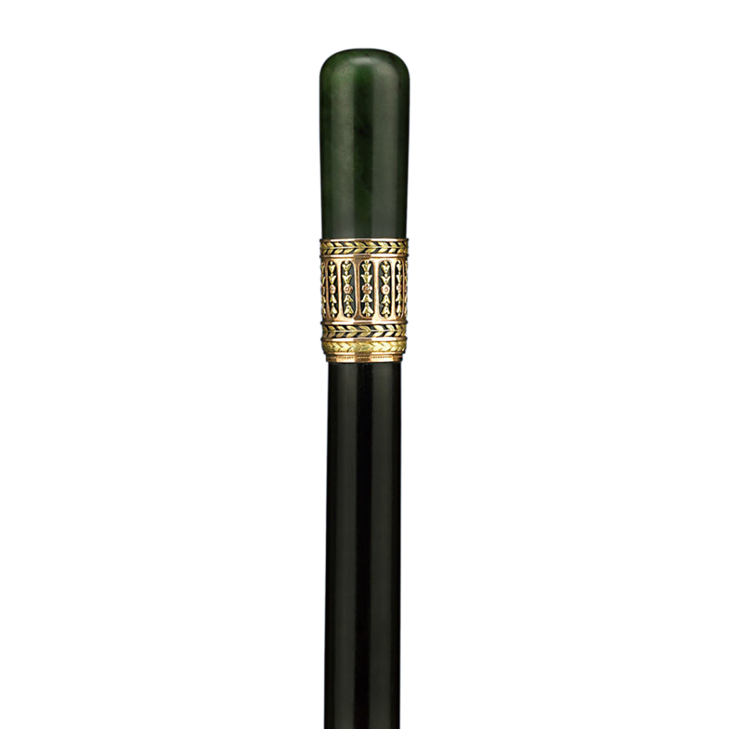 The knob of this remarkable Fabergé cane is crafted of solid, polished nephrite jade. Created by Henrik Wigström, 1908-1917.