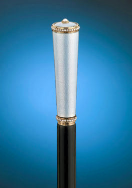 An elegant cane was crafted by legendary Fabergé artist, Henrik Wigström.