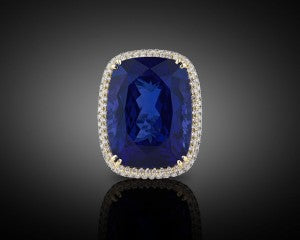 An incredible 45.26-carat cushion-cut tanzanite absolutely shines in this stunning ring