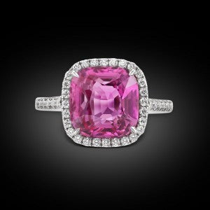 An all natural cushion-cut pink sapphire ring set with 0.78 glittering carats of micropavé-set diamonds