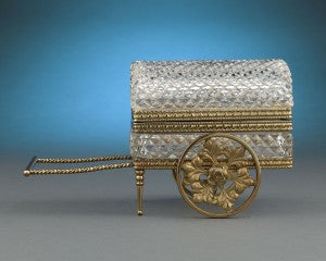 This absolutely charming French cut crystal trinket box is delightfully crafted in the form of a carriage