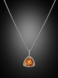 A radiant and rare 15.01-carat Mandarin garnet is the star of this eye-catching pendant