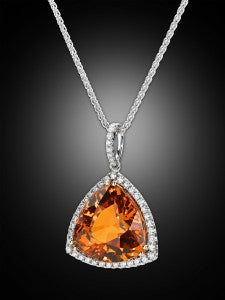 Displaying a fiery orange hue, this trilliant-cut gem absolutely dazzles