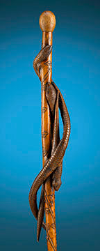 A triad of snakes slither their way up the shaft of this incredible folk art cane