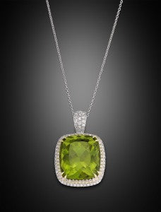 The 45.60 carat gemstone is bordered by diamonds totaling 1.06 carats