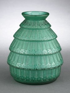 "Foliate concentric circles are layered to form this rare Lalique vase entitled ""Ferrières."""