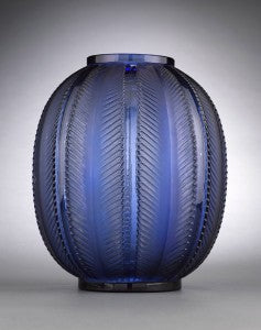Elongated palm leaves create a dramatic raised motif upon this superb example of Lalique's clean and elegant Art Deco style.