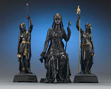 The Egyptian goddess Isis strikes a regal pose in this extraordinary bronze garniture by famed French sculptor Émile-Louis Picault
