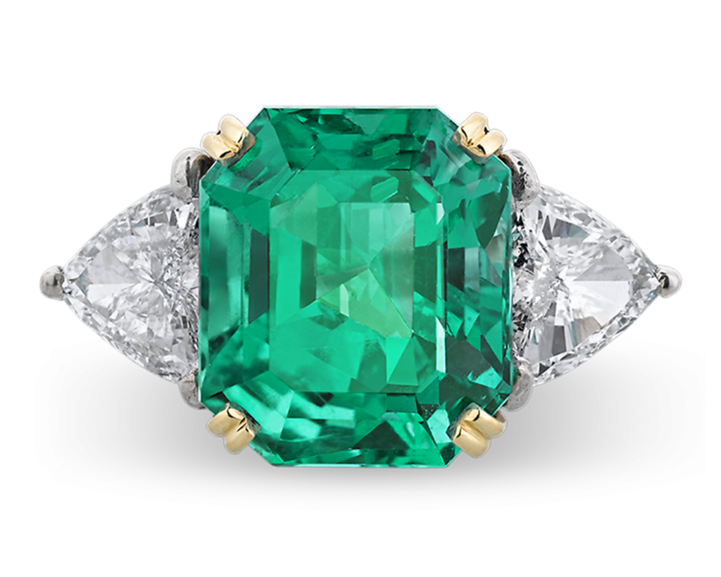 An extraordinary 13.65-carat Colombian emerald displays an incredible depth of color and brilliance in this eye-catching ring.