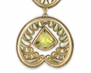 Finely executed enameling in shades of blue and green fill an exquisite 18k gold filigree design