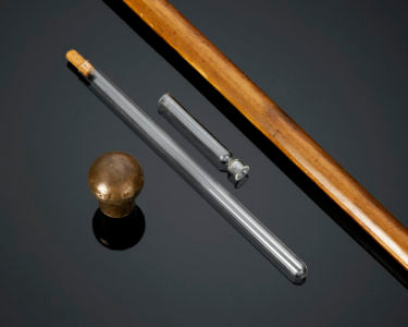 The Toulouse-Lautrec walking stick, a type of systems cane, conceals glass flask and a small drinking vessel
