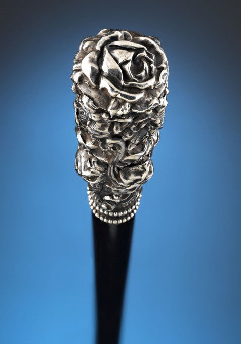 The highly detailed floral motif is the perfect complement to the sleek ebonized wood shaft