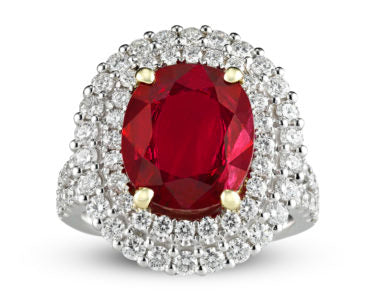 A dramatic oval ruby displays a brilliant crimson hue in this classic ring