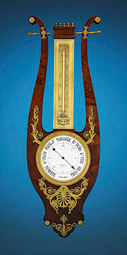 Empire Revival Barometer and Thermometer. Designed in the Empire taste, the barometer and thermometer are mounted in a beautiful lyre-form mahogany frame accentuated by exquisitely detailed ormolu mounts.