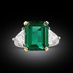 """An outstanding 6.02-carat emerald exhibits the perfect """"Old Mine"""" green hue in this classic and captivating ring"""