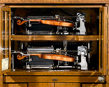 The machine has two independently playing 64-note violins and a 44-note piano