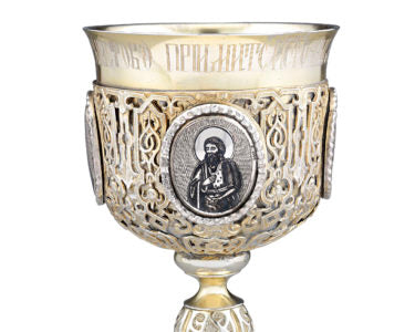 Featuring wonderful plaques of various saints and symbols of martyrdom surrounded by repousséd and chased motifs, this exceptional 19th-century silver gilt chalice is a beautiful specimen of Russian silver craftsmanship