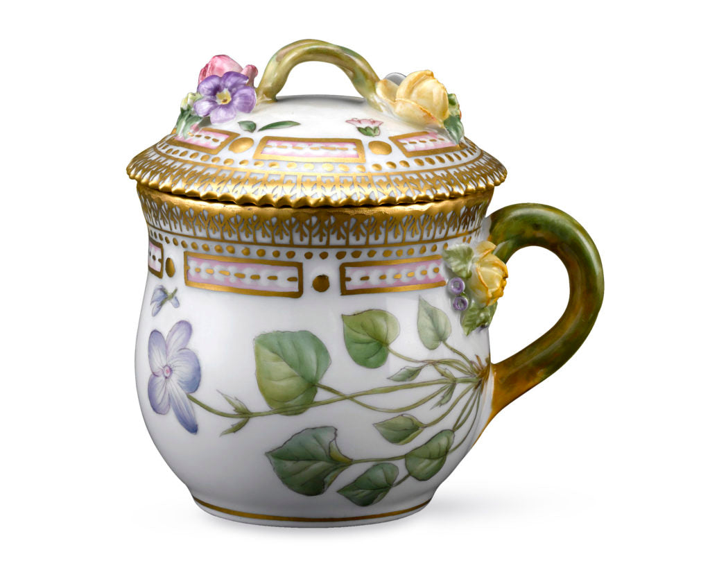 This diminutive demitasse cup features sculpted flowers on the lid and handle.