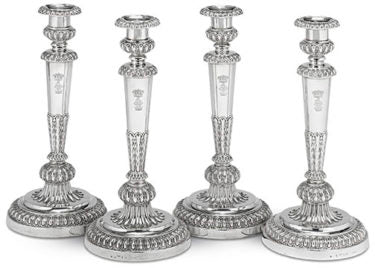 This rare and important set of four George III-period silver candlesticks were created by the renowned silversmith Matthew Boulton. Sterling works by Boulton are a rarity, especially those exhibiting the superior workmanship seen in the present examples