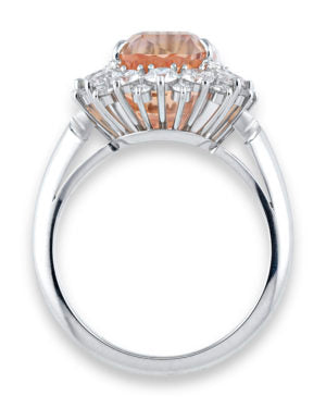 This stone is accompanied by a certification that states its origins as Ceylon, modern day Sri Lanka, whose mines produce the finest padparadscha gemstones
