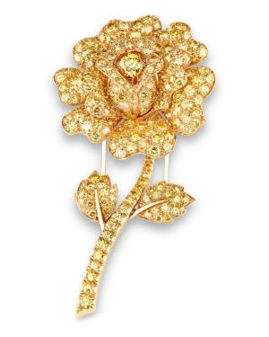 Crafted by Van Cleef & Arpels with approximately 12 carats of vivid yellow diamonds, this charming brooch depicts one of the most recognizable botanicals: a rose.