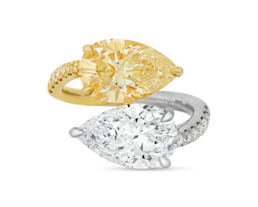 Fancy Yellow and White Diamond Bypass Ring, comprised of two pear-shaped stones