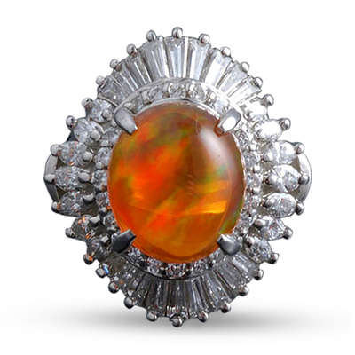 This fire opal and diamond ring exhibits some play-of-color.