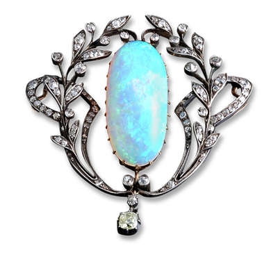 An antique Edwardian opal and diamond pendant.