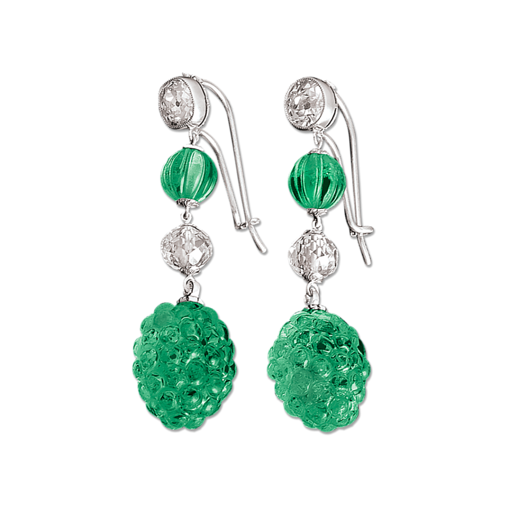 Colombian emeralds are intricately carved in this pair of earrings. Totaling 19.17 carats, the emeralds are GIA certified.