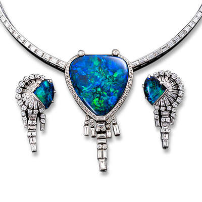 A beautiful black opal and diamond jewelry suite.