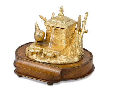 "This bronze musical inkwell is a picturesque scene with a glass ""fountain"" and three gilt bronze bids."