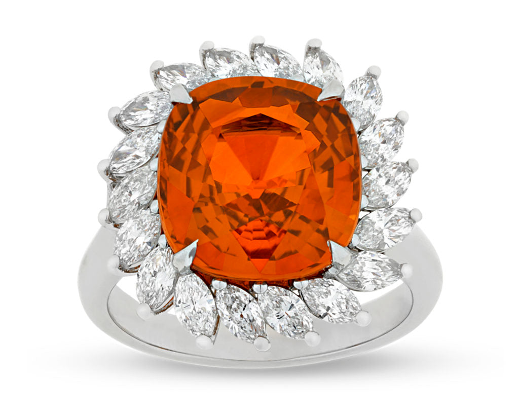 An Orange Sapphire and Diamond Ring