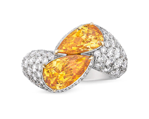 31-1574 Fancy Vivid Yellow-Orange Diamond Bypass Ring, 3.31 Carats