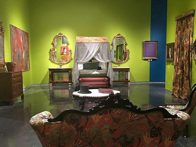 """The """"Juliet's Potion"""" green used in the bedroom was also used in Hunt's new Brooklyn Studio. The pair of Gilt Rococo Mirrors and Regency Rosewood Settee are on loan from M.S. Rau Antiques."""