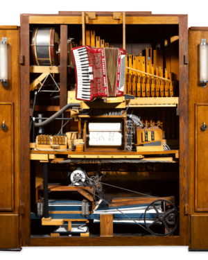 The Orchestrion operated using paper rolls, like earlier player pianos, to direct the instruments within. The mechanism contained a powerful motor, pipes and vacuum to play the instruments, creating a breathtaking level of sound.