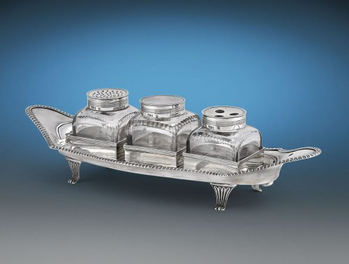 Boasting an elegant, balanced design and its original glass pots, this inkwell is a fine example of silver by the second generation of Bateman silversmiths.