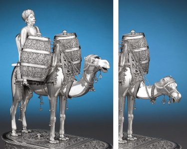 An incredible and rare Indian silver mechanical tea urn. The head of the camel dips down to pour tea and milk.