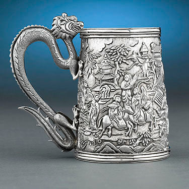 This Chinese Export Silver Tankard features an incredibly detailed dragon handle