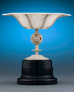 Chinese carved ivory tazza with a puzzle ball stem, Circa 1820