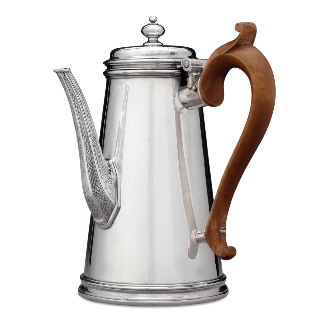 When wood, hardstones or other natural or porous materials are used in a work of silver, make sure to avoid applying polish to those areas, such as the wooden handle of this Paul de Lamerie Britannia Silver Coffee Pot.