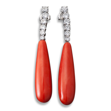 These coral earrings are sleek and sophisticated, but the organic coral is too delicate to put in an ultrasonic cleaner.
