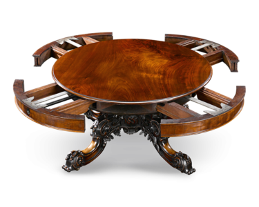 The ingenious wind-out screw mechanism allowed the table's base to accommodate concentric leaves.