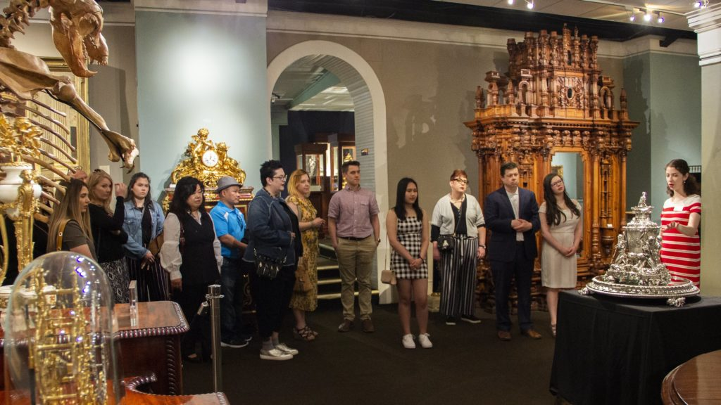 The Rau for Art Scholarship Finalists get a tour of the M. S. Rau Gallery