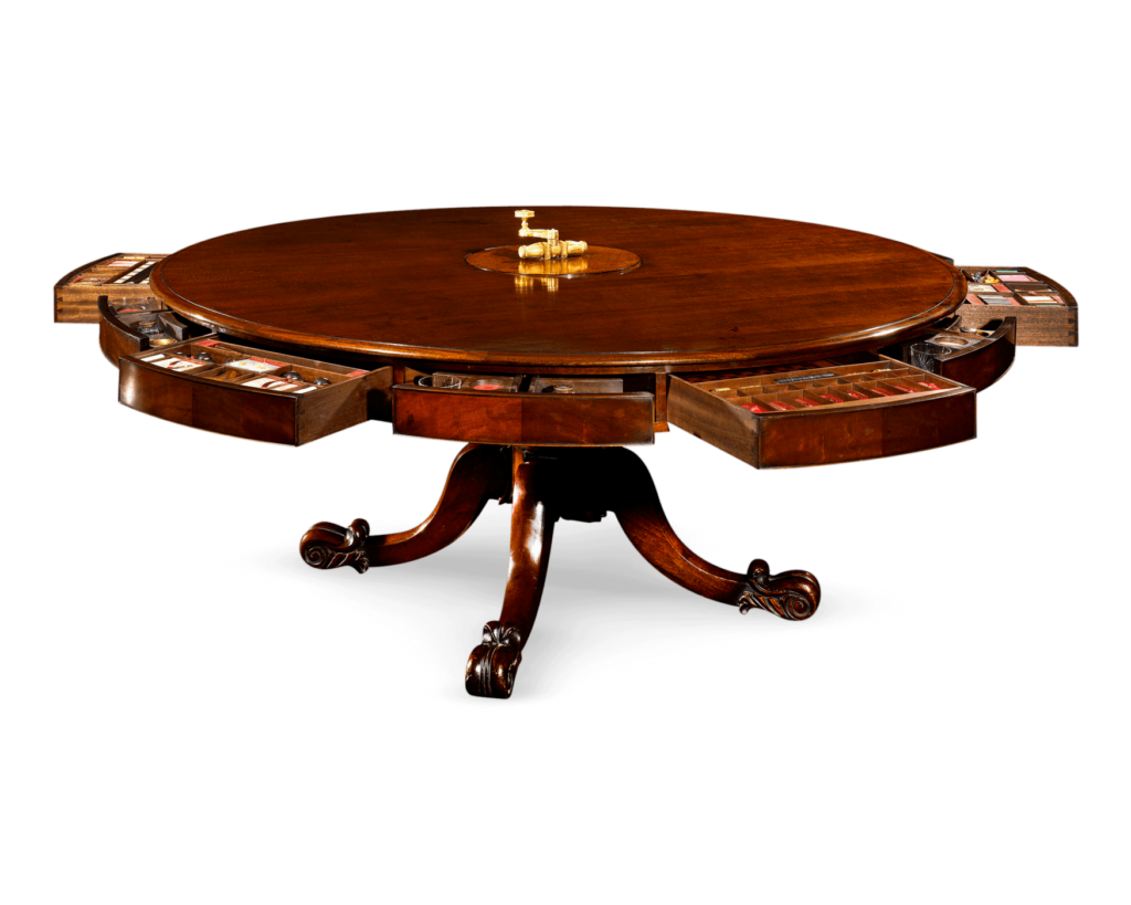 Irish Mahogany Games Table. A work of extraordinary beauty and rarity, this magnificent Irish mechanical dining table transforms into a stunning games table with just a few turns.