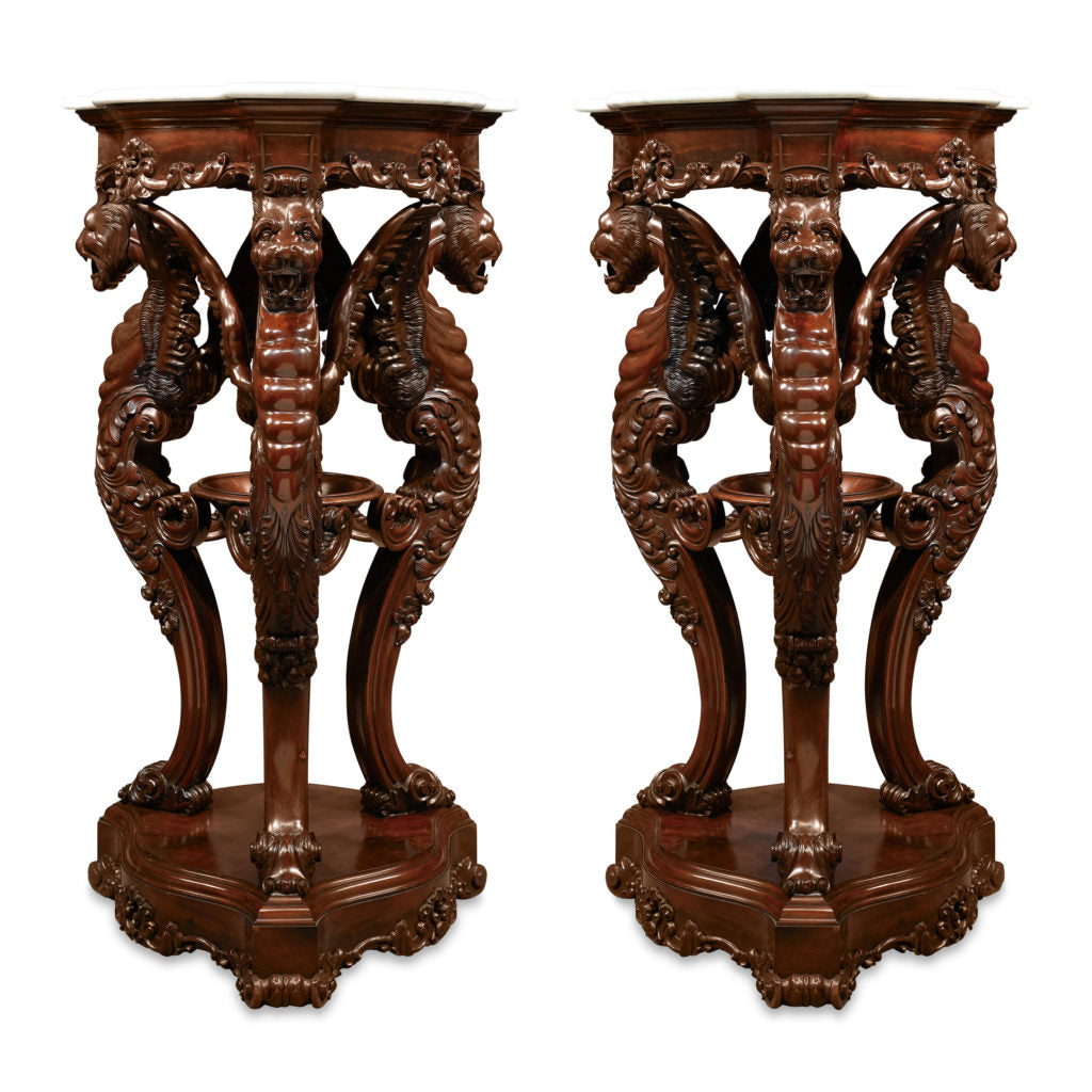 Outstanding and highly skilled artistry distinguishes these rare Irish pedestals. The powerful carvings, supporting white marble tops, marks these stands as treasures of their era.