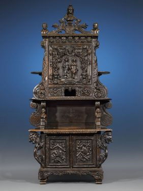 Carved of solid walnut, this cabinet celebrates the art and industry of the Louisiana Territory. It was created for the 1904 St. Louis World's Fair.